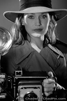 A great image for the agents - recording images, female detectives, and owning the film noir style.