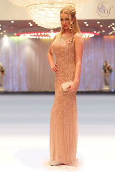 Long beaded nude high neck dress with soft full skirt SP276
