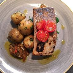 #servedbyname at The Kings Head in #Wye #LochDuart salmon with wild sea astor, saute potatoes & tomato, olive vinaigrette #delicious #spring #menu #eatmorefish Read Less