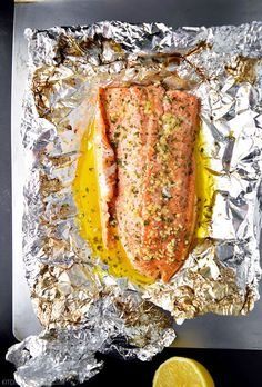 Easy lemon, garlic, and butter steelhead trout recipe prepared in foil.