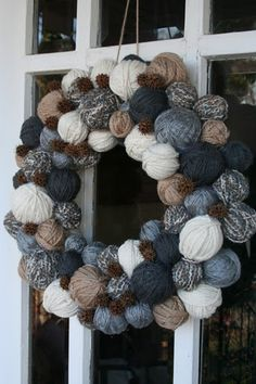 Cute yarn ball wreath. I am going to make one that is various shades, textures of white yarn for christmas over my fireplace this year!!!