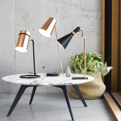The Beacon Lighting Monlue 1 light tapered table lamp with copper shade and black base
