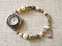 Scroll-work Watch with Silver Plate Beads, Pearl, Crytsal  Materials: Watch Face, Pearl, Sterling Silver Plated Beads, Crystal, Rhinestone