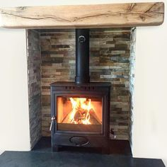 One of this weeks fits by Scott The Ecoburn Plus 5 Widescreen Defra Approved Stove with bespoke oyster slate chamber slate hearth and wooden beam. Chamber Ideas, Slate Fireplace, Wood Burner Fireplace, New Stove, Stove, Front Rooms, Interior Design Living Room, Fireplace, Wood Burning Fireplace