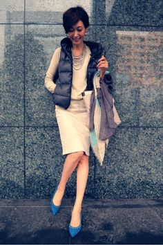 Sweater, pencil skirt, puffer vest, pointed toe shoes (flats)