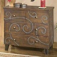 furniture tacks hammered into an old dresser (could make ANY pattern you want!)