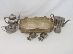 Antique & Vintage Silver Plate Serving Items on Tray. Various makers and ages. Handled tray, tea pots, tea caddy, covered bowl, figural salt cellars