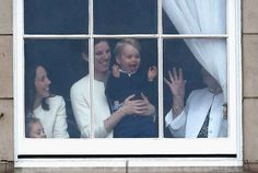 Just prior to the event, an excited Prince George was seen in the arms of his nanny, waving from the window of Buckingham Palace.