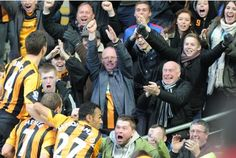 Hull City players and fans celebrate David Meyler's goal - City Quiz - Hull City, Liverpool, First Time, Mickey Mouse, Fans, Soccer, David, Football, Group
