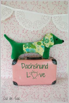 Ecofriendly stuffed sausage dog made with upcycled by bouclenoire, $24.00. So cute, love the concept. Canada Seller. woof woof !