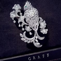 """""""New from the #Graffdiamonds Workshop - a sublime Diamond Parrot Brooch."""""""