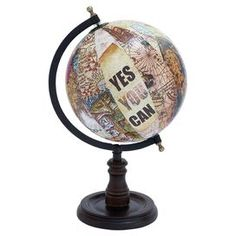"""Metal globe with a collage-inspired design and turned base.  Product: GlobeConstruction Material: Metal and woodColor: MultiDimensions: 15"""" H x 8"""" Diameter"""