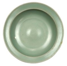 """Chinese Longquan celadon glazed small shallow bowl, Song dynasty, with a wide everted rim and a sloping body, raised on a short tapering foot, 5.5""""w"""