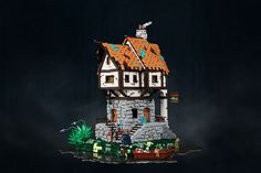 A moody medieval inn on a lake, built by César Soares.