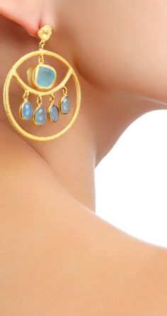 Zariin presents 22kt gold plated earrings with uncut and faceted blue topaz available only at Pernia's Pop-Up Shop