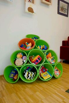 Buckets and zipties for playroom storage. Try this for kitchen toys or dress up stuff.