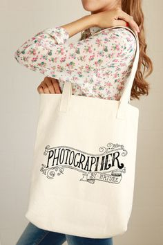 """Whether you are born with the talent of photography or develop it, this tote bag is inspired by you! - 12.0 oz., 100% cotton canvas - 22"""" handles - Reinforced bottom - The design is printed using wate"""