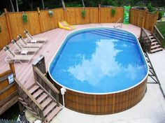 Pools - Traditional Above Ground Pool Decks With Small Wood Staircase Chaise Lounge Chairs Colorful Floating Bed Large Wood Fence: Awesome Ground Pool Decks Design Ideas For Your Modern House