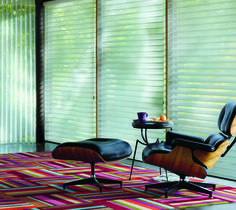 Brighten any space with a bold colorful rug and the light filtering beauty of Silhouette® window shadings ♦ Hunter Douglas window treatments #LivingRoom