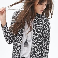 Leopard drape front sweater Beautiful black and white leopard print drape front sweater from Forever 21.                            Extremely comfortable and cozy and great for layering!                                                                  Worn only twice. Excellent condition.                           20% off bundles! Forever 21 Sweaters