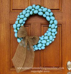 how to make a faux robin s egg blue wreath itching4spring, crafts, easter decorations, seasonal holiday d cor, wreaths, Finished egg wreath with adorable burlap bow