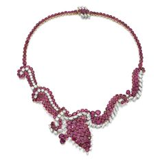 RUBY AND DIAMOND NECKLACE, 1950S Designed as a series of stylised paisley motifs, set with variously shaped faceted rubies, marquise-shaped and brilliant-cut diamonds, length approximately 390mm, fitted case by Carl Ernst Wiesbaden.