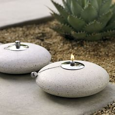 White saucer orbits a soft glow in poly/resin/stone for a modern take on midcentury terrazzo. Burns the midnight mineral or citronella oil for up to eight hours. Center canister removes for easy refills. Oil not included.