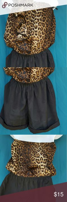 Cheetah print romper It is a strapless romper with a very stretchy waist band. Super comfortable and super chic. The top has an elastic band to make sure it doesn't fall down ?? it stays put lol even if you're running around. Papaya Other
