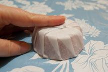 Simple and inexpensive soap wrapping tutorial to give your round soaps a more professionally packaged look.