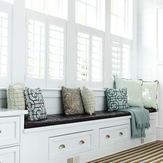 Great window seat with storage! Love the big windows and woodwork, too.