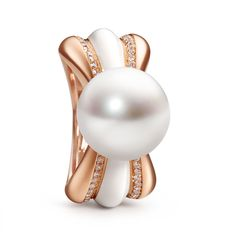 The Couture Collection, Chrysanthème, a flower and its corona. South Sea pearls, brilliant-cut diamonds, white enamel and rose gold by Schoeffel. #pearls