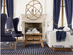 navy living room. basket next to couch with magazines and books