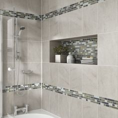 Clean and sleek! Modern bath with mosaic tile detail tub & shower.