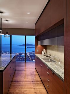 High-rise apartment with functional minimalist modern kitchen with marble surface