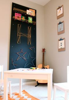 Playroom: Easy DIY Pegboard Art -- paint a pegboard black to make the colors really pop, and then chop a bunch of colored pencils in half for the dowels. Add some colorful rubber bands or string and you're done. I love how this is open-ended and encourages creativity!