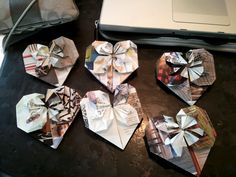 Oragami Hearts- These are mine.  This is the site I got them from! Awesome.  http://inkstainswithroni.blogspot.com/2010/02/fancy-origami-heart.html