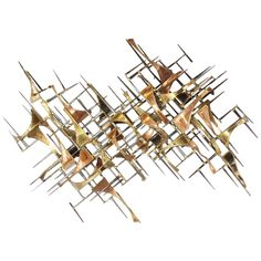 Mid-Century Brutalist Brass Wall Sculpture | From a unique collection of antique…