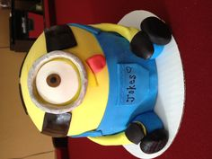 Dispicable me cake ... Like us on Facebook!! www.facebook.com/angiesheavenlycreations