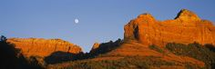 Low Angle View Of Moon Over Red Rocks Photograph by Panoramic Images