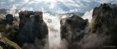A panoramic photo of the Monastery of Varlaam above the clouds in Meteora, Greece.