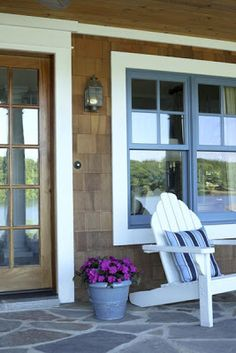 Lakeside cottage...lots of Adirondack by grass area