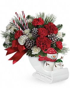 Send a Hug® Open Sleigh Ride by Teleflora  Bouquet