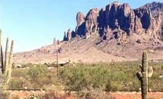"Located just east of Phoenix, Arizona is a rough, mountainous region where people sometimes go... only to never be seen again. It is a place of mystery, of legend and lore and it is called Superstition Mountain. According to history, both hidden and recorded, there exists a fantastic gold mine here like no other that has ever been seen. It has been dubbed the ""Lost Dutchman Mine"" over the years and thanks to its myst"