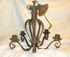 Wrought Iron Hanging Chandelier Lighting - Ceiling - Light Fixture - Vintage - Antique - Architectural Salvage, via Etsy.