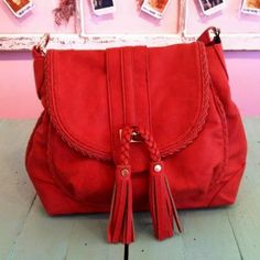 Red Urban Expressions bag with braided tassels
