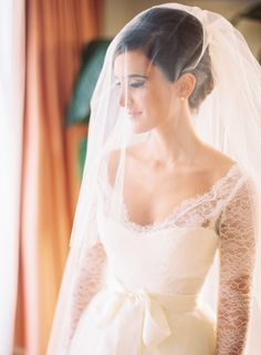 Ceremony dress, Veil: Monique Lhuillier - Mandana & Ben | Glamorous Florida Wedding at The Breakers by Braedon Photography - via Snippet & Ink