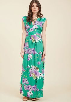 <p>Glide through your day feeling dreamy as can be in this printed maxi dress! An ethereal spread of white and purple flowers adorns the sea green hue of this V-neck, short-sleeved frock, creating a look that is both vibrant and poised.</p>
