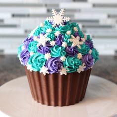 Frozen Birthday Giant Cupcake. Pinned for color inspiration on top. Would change base color.