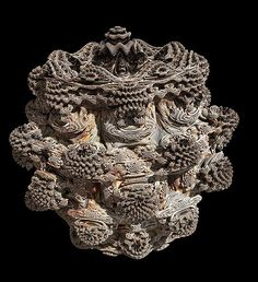 A 3D fractal (ie mandelbulb) of power 9 created by the Visions of Chaos program