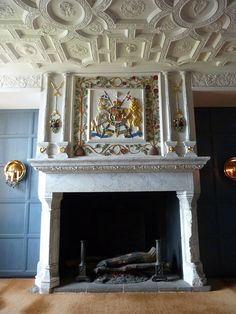 Edinburgh Castle - Fireplace in Royal apartments        There are two rather magnificent fireplaces in the Royal apartments at Edinburgh Castle. This is the first one that you encounter. The coat of arms over the fireplace is that of the United Kingdom rather than just Scotland as can be seen by the presence of the Lion of England as a supporter and St George's Cross behind the lion's head.